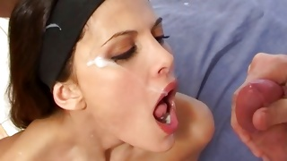 Great looking bitch is licking the cumming huge penis