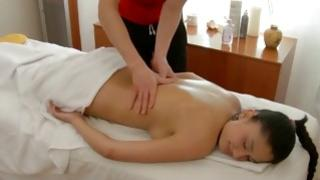 Masseur is pressing gf's ass cheeks while inserting his wang inward her fissure