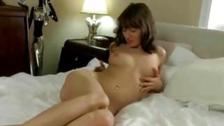 Dark-haired angel is hollering wildly as is deeply riding on the rubber sex toy