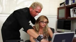 Passionate sluttish wench looks sexy while typing on laptop