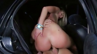 Blondie is kneeling to hand job the yummy cock